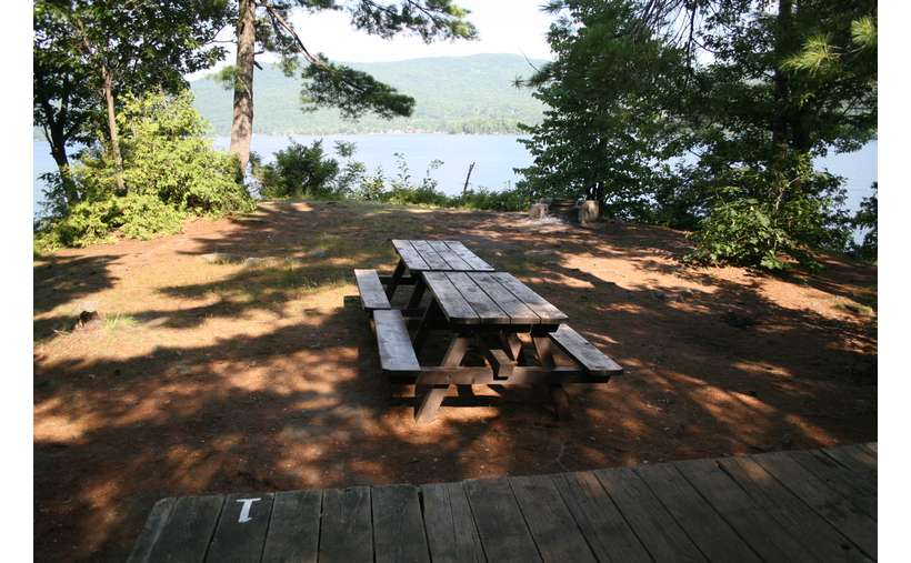 two picnic tables near a tent platform with the number one on it