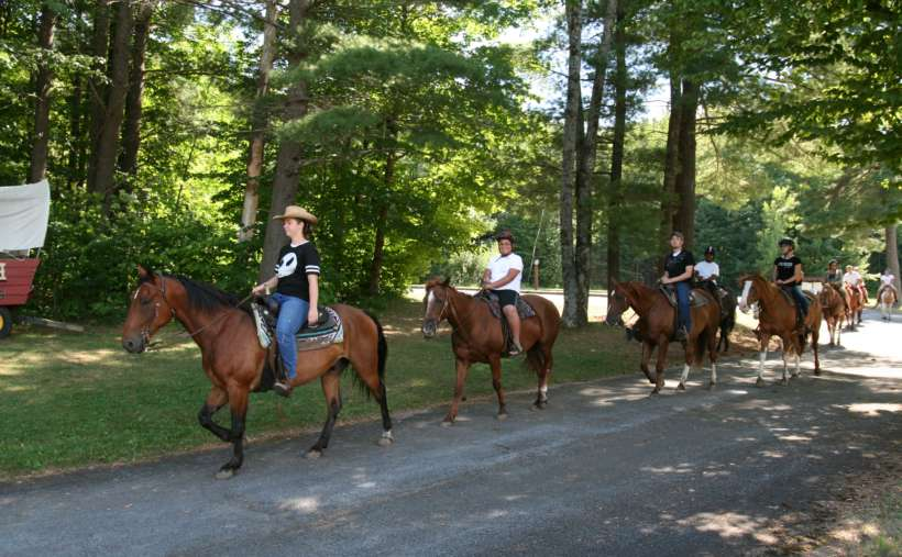 Go for a family horseback ride right at Roaring Brook Ranch.