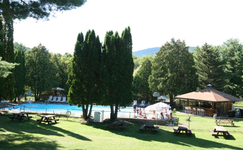 Take a trip over to the outdoor pool and picnic area during a sunny afternoon.