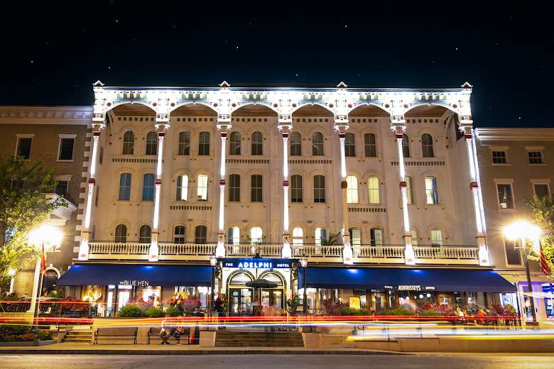 large view of the front of the adelphi hotel at night