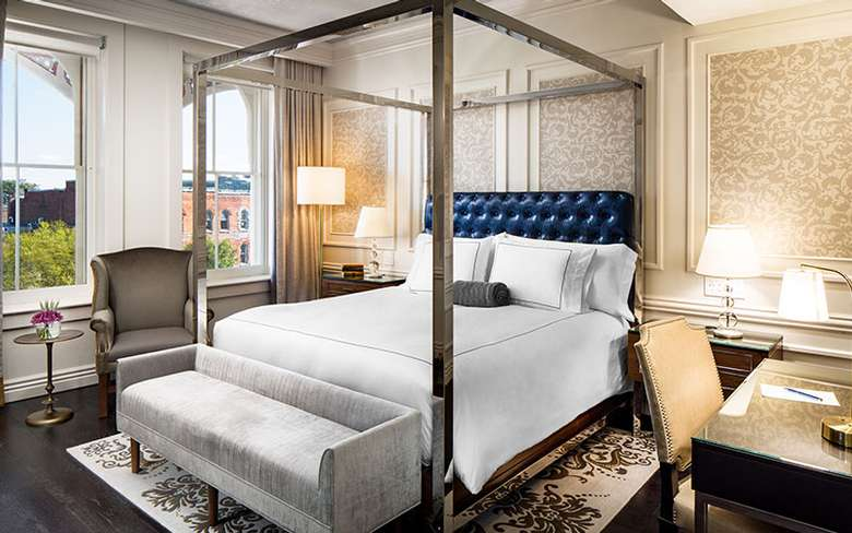 a luxurious guest room and bed