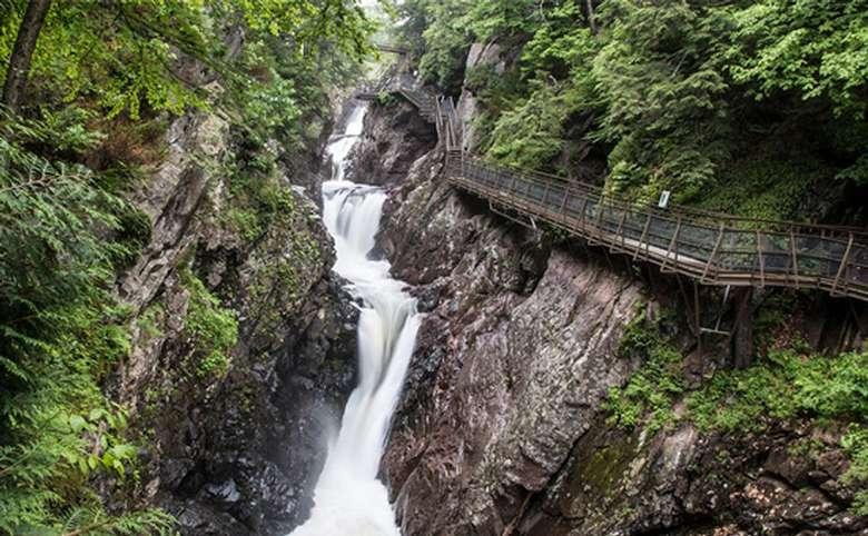waterfall near a bridge