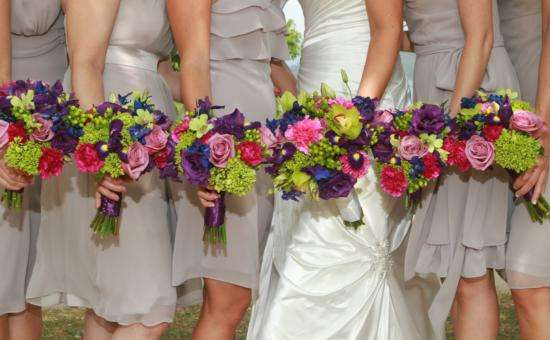 view of brides and bridesmaids holding flowers