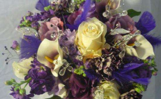 Purple and white flowers in bouquet