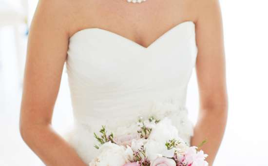 Bride holding white and pink flowers