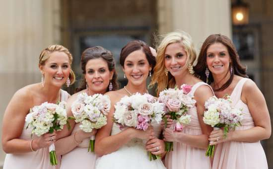 Bride and bridesmaids in pink and white with matching bouquets