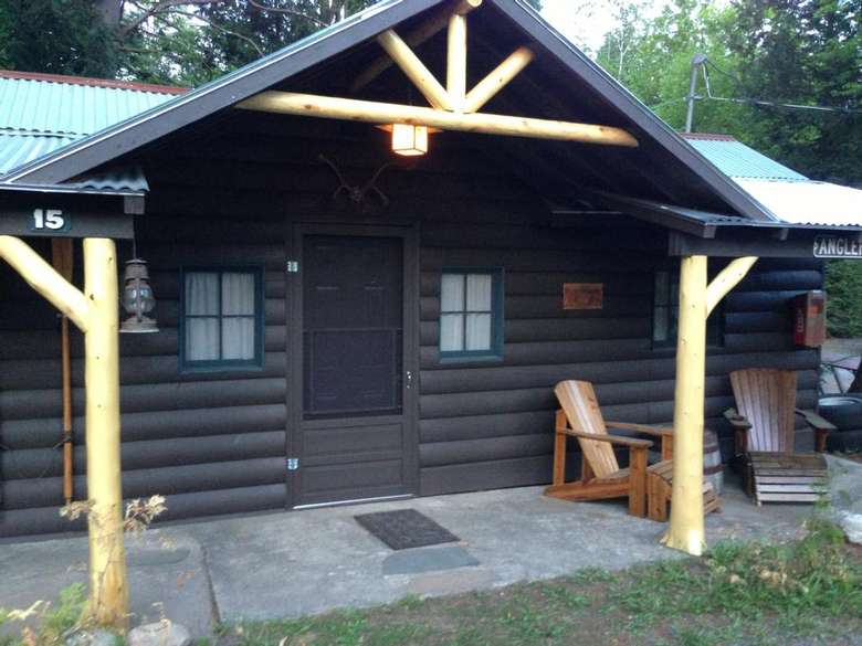 the front of a dark brown cabin