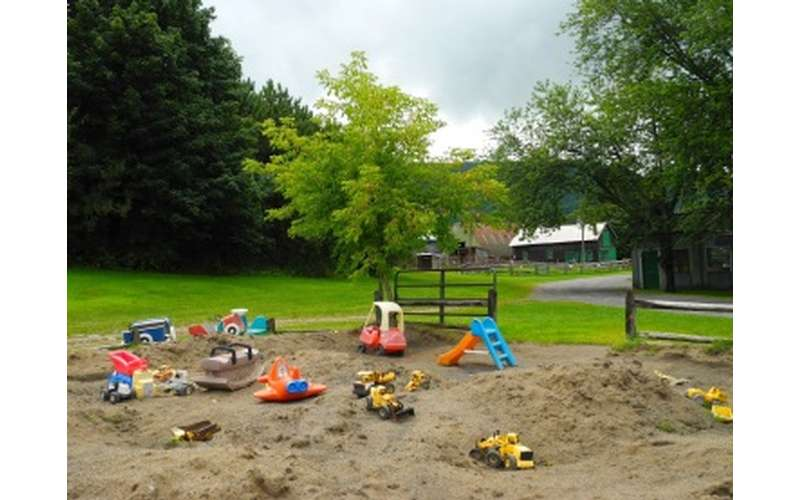 a sandy play area for kids with toys
