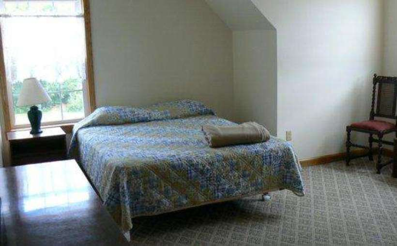 bed with blue bedspread