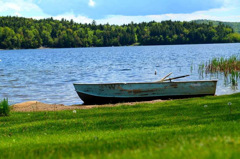 a rowboat by the water