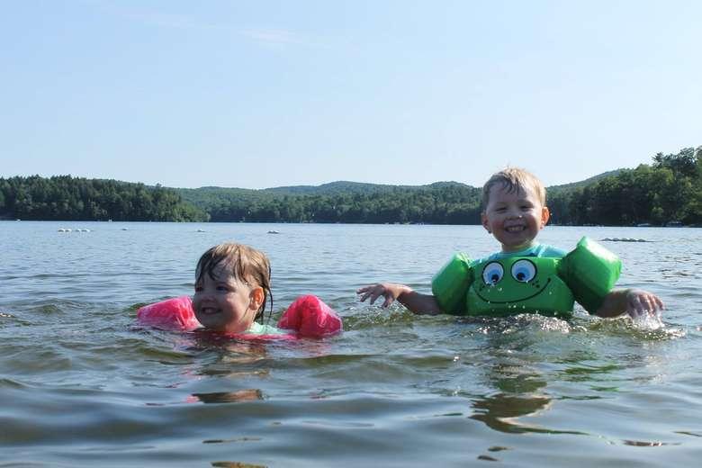 two kids swimming