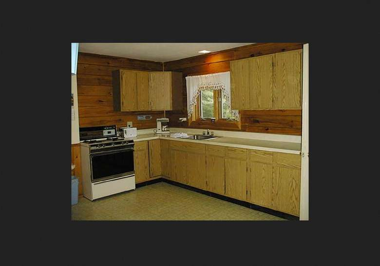 kitchen area with a lot of cabinets