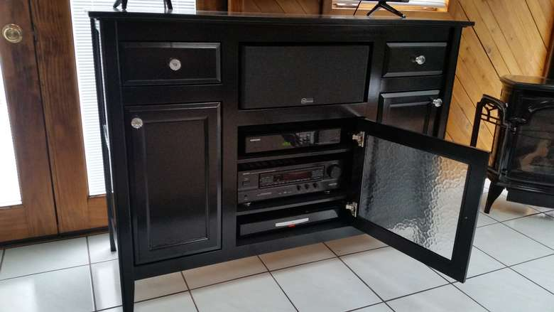 frosted glass doors on a black entertainment center