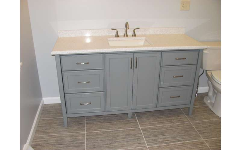 a custom built  bathroom cabinet with a sink