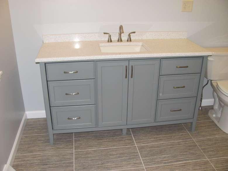 a custom built  bathroom cabinet with a sink