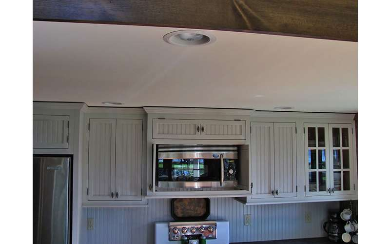 a microwave set within a row of upper cabinets