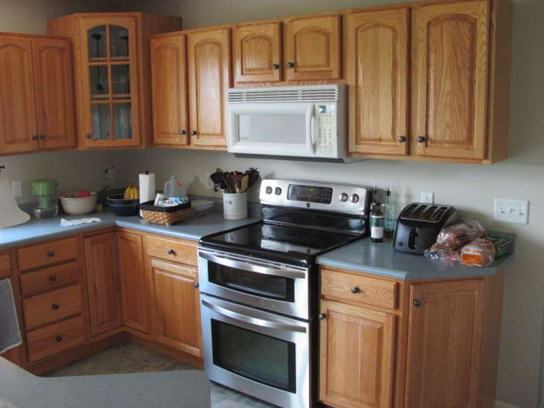 BEFORE KITCHEN CABINET RE-FINISHING