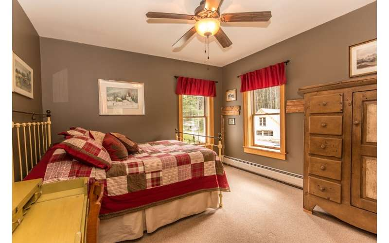the hemlock room is on the second floor and features corner windows a full sized iron bed and more