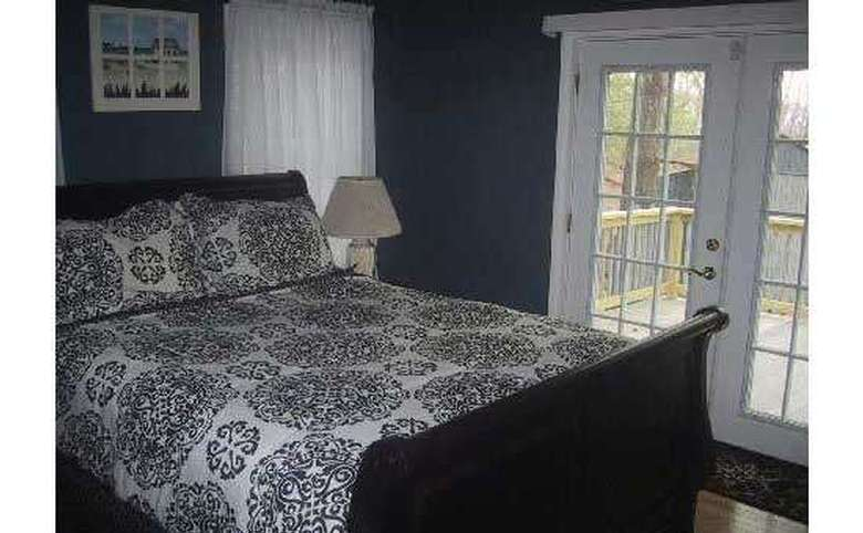 bedroom with a queen size bed and french doors leading outside