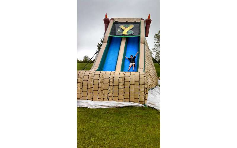 A boy sliding down an inflatable slide