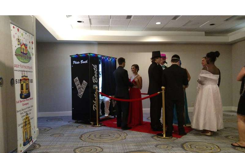 Kids in formalwear in line for a photo booth