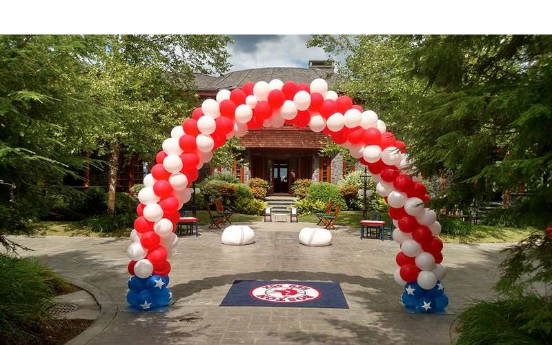 A red white and blue balloon arch