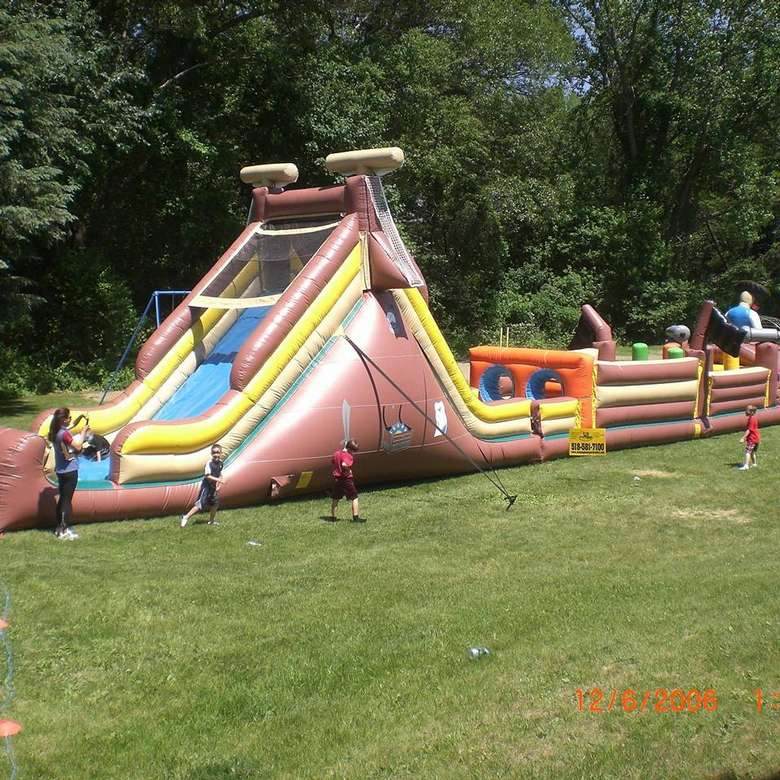 Kids running through an inflatable obstacle course