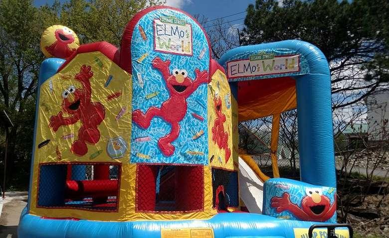 An Elmo World bounce house