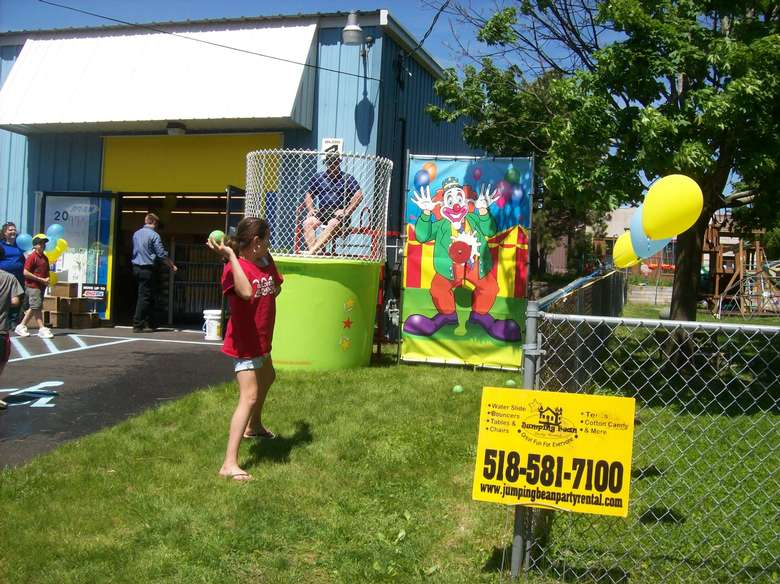 Girl throwing a ball at a dunk tank