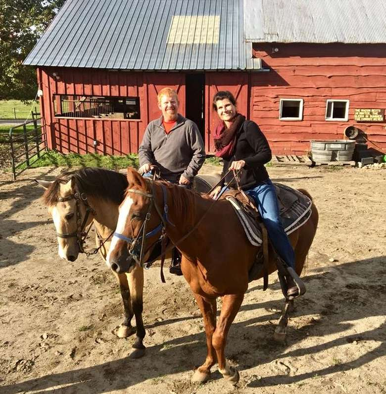 two people horseback riding