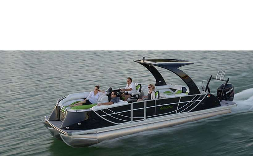 a boat with a large black motor in the back and people sitting inside