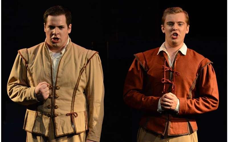 two men singing on stage