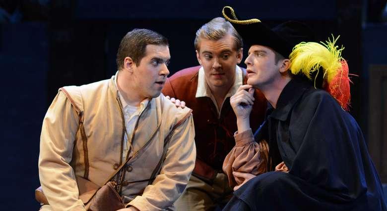 three men acting on stage