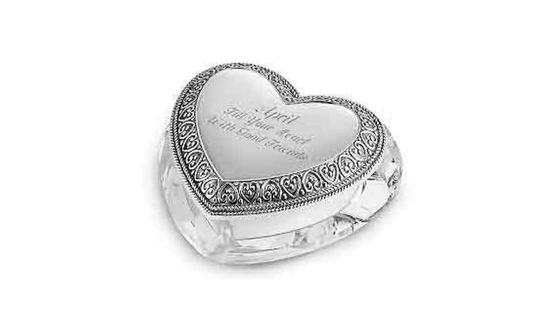 heart shaped crystal with a message engraved on the top