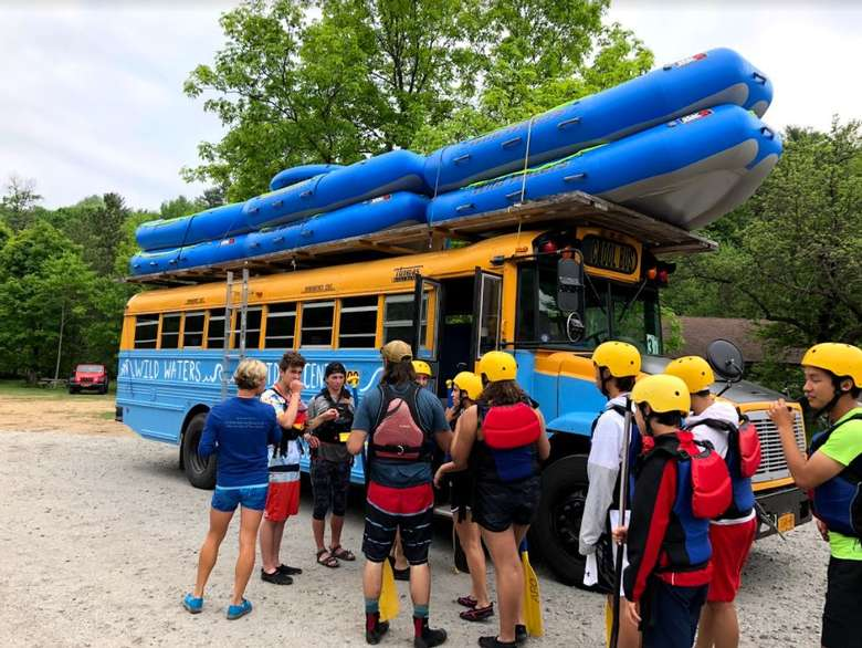rafts on a bus, people standing around