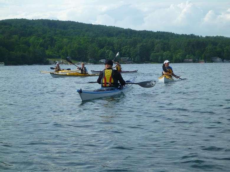 group of kayakers on lake george