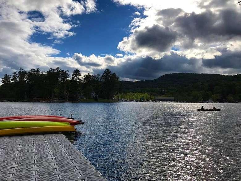 kayaks laying on a dock overlooking lake george