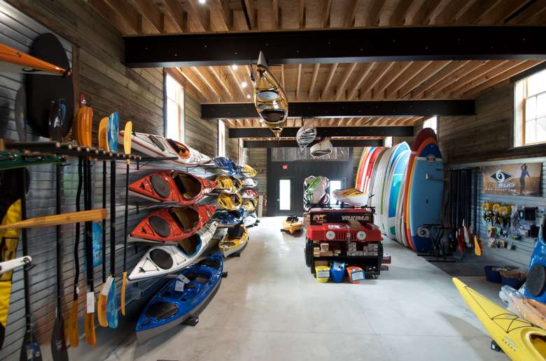 kayaks and paddleboards ready for sale
