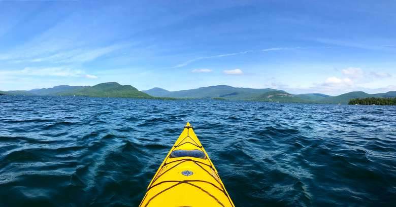bow of a yellow kayak on lake george
