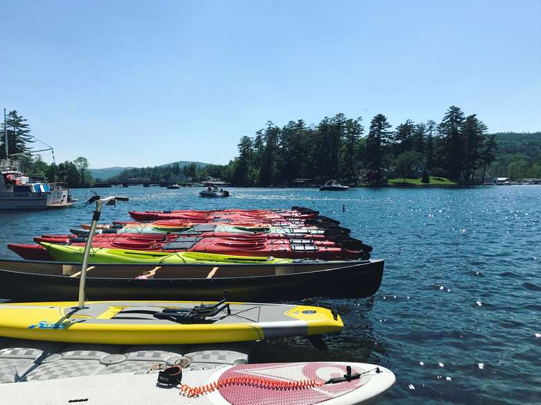 row of kayaks ready for launch