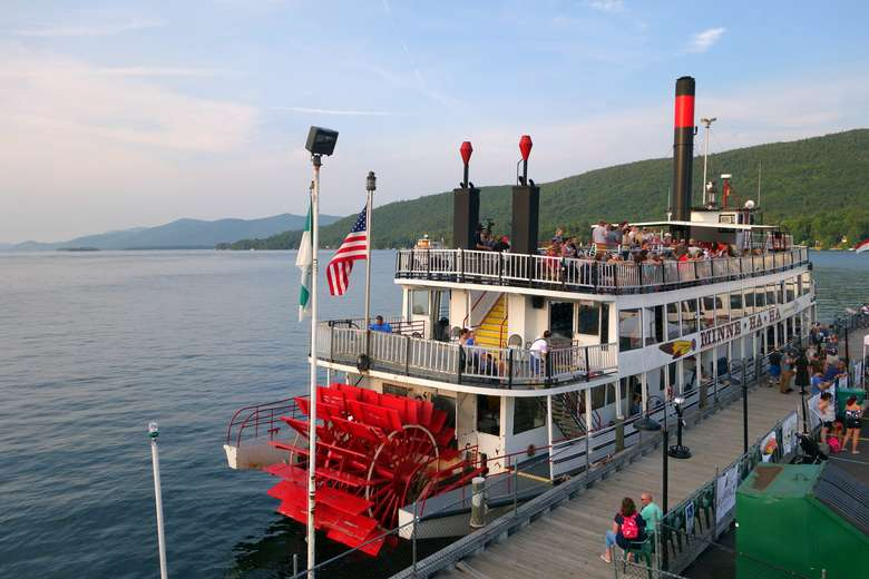 the minnehaha paddlewheel steamboat docked at its pier on lake george