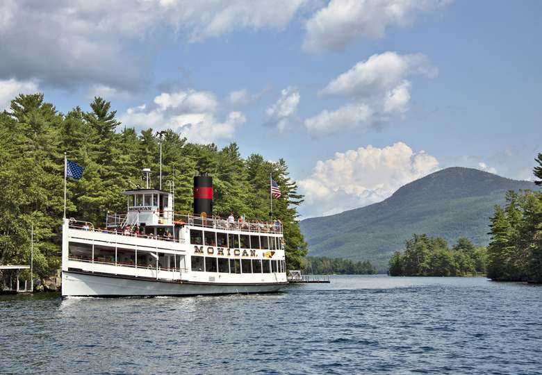the mohican cruise ship driving past islands on lake george