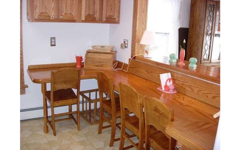 chairs along a counter inside a house