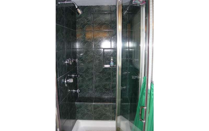 a shower with glass doors
