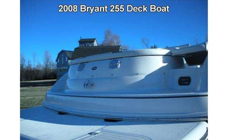 a large white deck boat