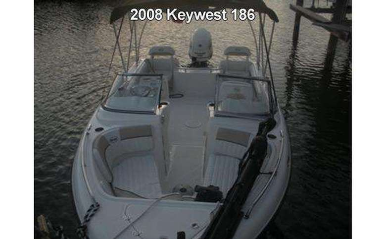 facing the front of a key west motorboat on the water
