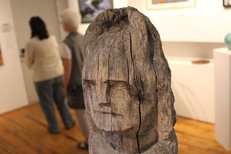 head sculpture in gallery