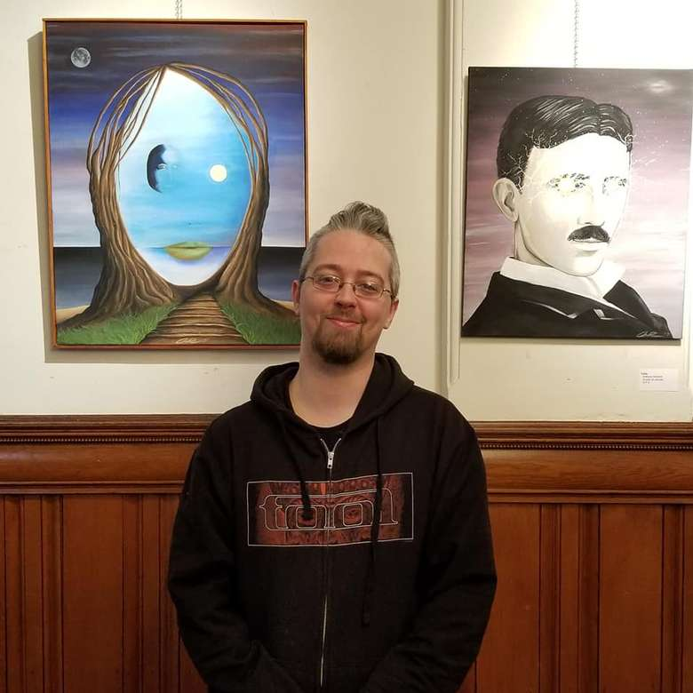 artist in front of work