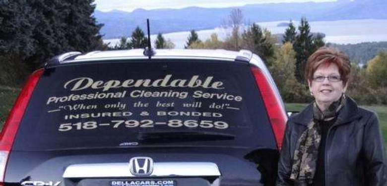 woman standing next to car with Dependable Professional Cleaning Service decal