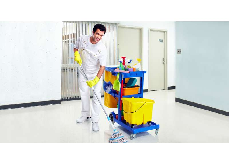 a man dressed in white by a janitor's pull station